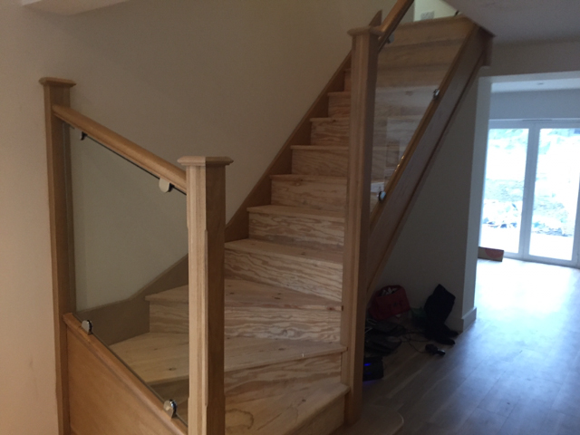 Bending Staircase With Glass Banister